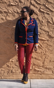 Red and blue houndstooth pants, red and blue blazer, yellow blouse